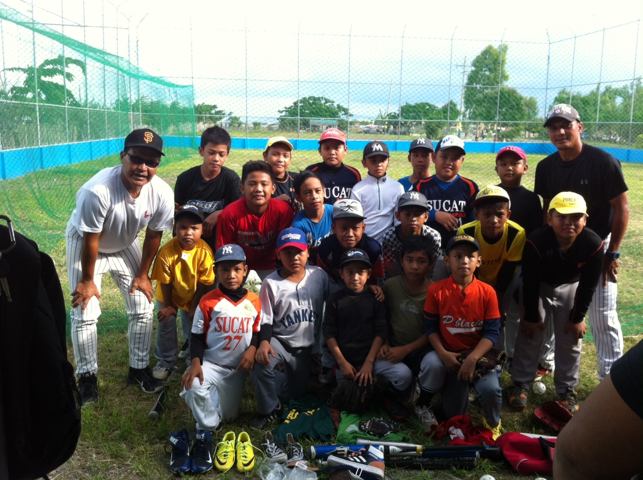 With some boys from his baseball program in the Phillippines